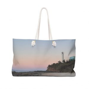 This Weekender Bag Lighthouse is one of many beach themed tote bags you can buy online from the Beach Scenes store.